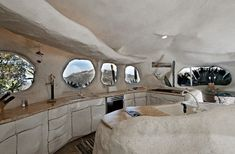 """Kitchen in a """"Flinstones"""" inspired house that is also apparently for sale!"""