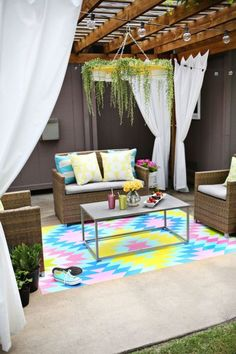 "Paint a Concrete Floor - Add some whimsical color to your patio area by painting a your own backyard ""rug"" directly onto the concrete."