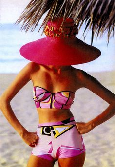 Mod spin on 1950's swimwear. The colors are a burst of excitement. The hat is a necessity, not just an accessory