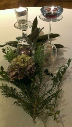 A classic winter center piece.  Turn wine glasses upside down and place Christmas ornaments inside. I used snowmen and Christmas balls.  Place any kind of small votives on top.  Use fresh greens from outside your house. (I used a magnolia branch, a boxwood sprig and a pine branch) .  I used dried hydrangeas that I was saving for my Christmas tree.  You can also put more Christmas balls on the greens.  It was easy, cost me nothing and made great centerpieces for a Christmas dinner.