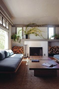 I would say that this is generally too modern for me, too square, but this room is so calm and peaceful, so inviting, I'm really drawn to it. Love the natural light and the plants, the simplicity of the fireplace wall is nice. Like I said, very calming room.