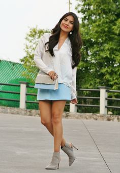 Shop this look on Lookastic:  http://lookastic.com/women/looks/white-long-sleeve-blouse-light-blue-crossbody-bag-light-blue-mini-skirt-grey-ankle-boots/5309  — White Silk Long Sleeve Blouse  — Light Blue Leather Crossbody Bag  — Light Blue Mini Skirt  — Grey Cutout Suede Ankle Boots