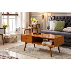 Give your living room or entertainment center a splash of mid-century modern charm with the Bowie Media Coffee Table from Porthos Home. The solid wood construction ensures durability, while the range