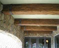 Beams with metal for dining room ceilings...beautiful!