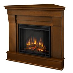 The Chateau Corner indoor fireplace features the clean lines and classic styling familiar to stone mantels, realized in wood. It includes a remote control, programmable thermostat, timer function, brightness settings and emits up to 4,700 BTU's of heat.