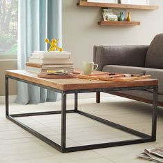 I love the clean lines on this wood and steel coffee table from West Elm / $349