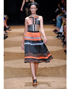Proenza Schouler Spring 2012  Through their lens, they redid low-cut swimwear suit shapes and flared skirts like you'd see at the sock hop. The update was in newfangled materials (the duo owns their own mills so they have free reign to create anything they want).