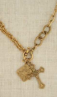 Brushed gold necklace with vintage pendant and vintage cross handmade in USA by ExVoto Vintage jewelry.