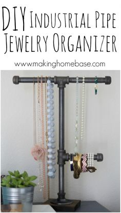 DIY Industrial Pipe Jewelry Organizer. I totally want to do a version of this with pvc pipe (cheaper?) will need to consider having something like that weighted.