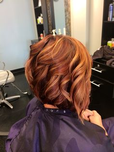 My new hair! Red with copper highlights, angled bob with beach waves. Mary at Silver Moon Hair Salon is the best!