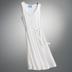 I've been looking for the perfect simple white dress to wear with everything. found it :)