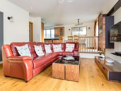 Unwind in the delightful living area with its sumptuous leather corner sofa, cosy window seat and flat screen TV. Lamb Corner House in Pooley Bridge is full of indulgent touches!