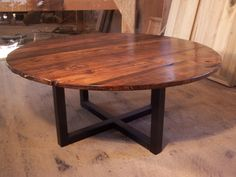 Large round coffee table with industrial metal base. $525.00, via Etsy.