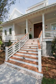 Beach House Architecture. Beach elevated House. Entry front. Siding. Hardiplank. Island Home. Raised Home. Siding Ideas. Stairs