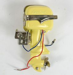 """Lang Craft toy electric outboard boat motor; vintage Japanese mfg., 3 1/2\""""H. Very good condition."""