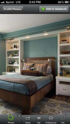 Built-in shelves framing bed.