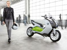 "An Eco-Friendly Scooter  This scooter, born in the concept and design offices of BMW Motorrad (see Concept C), is still in the project stage, but will definitely benefit from the innovations made during the creation of it's big brother ""Maxi Scooter"", such as the replacement of rear view mirrors with a system of cameras situated in the back."