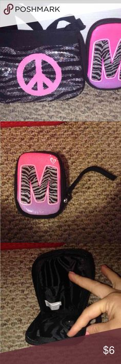 """Justice Girls bags Justice girls crossbody with a peace sign great shape! And justice girls pouch has an """"M"""" on it, lights up smoke free home! Justice Bags Crossbody Bags"""