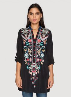 Chayanna Blouse Embrace gypset style in the Johnny Was CHAYANNA BLOUSE! This boho tunic top features a stunning embroidery design inspired by Native American dreamcatchers, weaving, and beading. Layer the CHAYANNA BLOUSE over a silk slip and tights as a mini-dress, or wear it with                jeans and a vest!  - Rayon Georgette - V-Neckline with Henley Button Front, Long Tabbed Sleeves - Signature Embroidery - Care Instructions: Machine Wash Cold, Tumble Dry Low