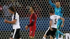 Cristiano Ronaldo (2nd L) of Portugal reacts after missing a penalty kick during their UEFA EURO 2016 Group F match against Austria