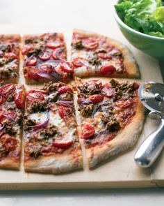 Hamburger and Grape-Tomato Pizza | Thanks to frozen dough and ready-made sauce, making homemade pizza is easy as pie. Provolone has a richer flavor than mozzarella, so you don't need as much.  | http://www.marthastewart.com/316190/hamburger-and-grape-tomato-pizza?czone=food%2Fcomfort-foods-center%2Fcomfort-foods-dishes&gallery=274796&slide=316190&center=854190