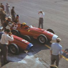 Monza 1957 - Italian GP - Luigi Musso leaves the pits. Note the change made to Hawthorn's Ferrari's air intake.