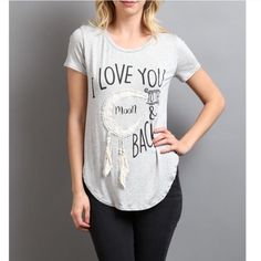 I love you to the moon graphic top Heather grey graphic top with hanging details. Super soft and super cute top to wear with leggings or jeans. 95% Rayon, 5% spandex. Please request size in comments, and I'll create a new listing for you!  Stock photos by April's Spirit. The Classic Tops Tees - Short Sleeve