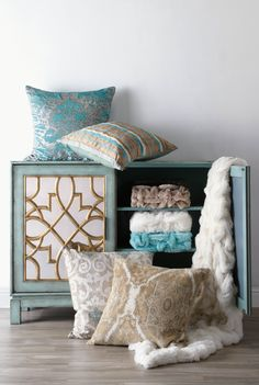 Affordable update: Infuse subtle hues and rich patterns into your space with pillows + throws.