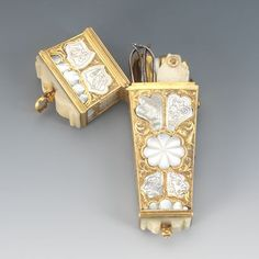 "1335. A Fine Carved Mother of Pearl Etui, ca. 19th Century 4"" x 1.30 x .75"" Tapered brass case with hinged lid, with engraved scroll motifs and carved mother of pearl inlay sections; interior with brass, ivory and mother of pearl clad instruments. Aspire Auctions"