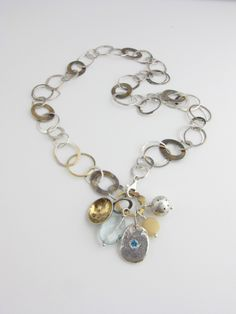 Necklace | Francine Walker. 'Charmer' Sterling silver, 24k, 14k, 10k, aquamarine, horn, blue topaz