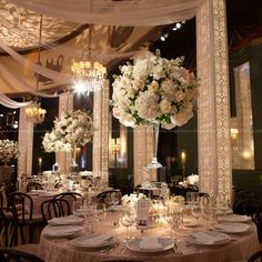 Heavenly ivory and rose floral profusions atop stunning crystal glass surrounded by glowing artisan crafted columns. Floral & Decor: KehoeDesigns.com, Photography: Liliane Calfee, Venue: Casino Club of Chicago