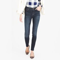 """Our skinny toothpick jean + a higher rise = a nipped waist and legs for miles (even without heels). This pair is crafted in premium Turkish cotton, which is famously slimming thanks to the perfect amount of stretch, and we dyed it in a clean, darker wash that complements everything. <ul><li>Fitted through hip and thigh, with a superskinny leg.</li><li>32"""" inseam.</li><li>10 3/4"""" leg opening (based on size 28).</li><li>Cotton with a hint of stretch.</li><li>Traditional 5-pocket…"""