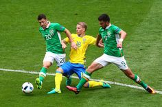 Oscar Lewicki (C) of Sweden competes for the ball against Wes Hoolahan (L) and Shane Long (R) of Republic of Ireland during the UEFA EURO 2016 Group E match between Republic of Ireland and Sweden at Stade de France on June 13, 2016 in Paris, France.