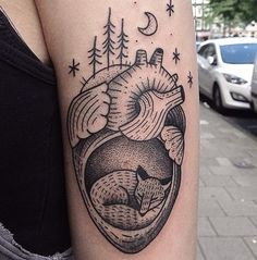 ... -and-white fox sleeping inside the heart tattoo on arm - Tattoos.pm