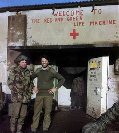 Rick Jolly (right) taking a rare break at the frontline medical centre he set up during the Falklands War