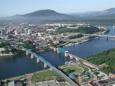 The Tennessee River as it travels through Chattanooga. From left to right: Walnut Street Bridge, Market Street Bridge, Olgiati Bridge.