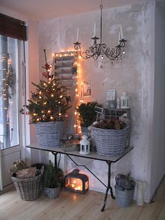 Entry with country, rustic Christmas home decor vignette Lots of baskets, pincones, and lantern.