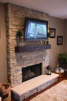 Stacked stone fireplace with reclaimed wood mantel. Exactly how I want mine in t… – Stone fireplace living room Stone Fireplace Wall, Tv Above Fireplace, Stacked Stone Fireplaces, Home Fireplace, Fireplace Remodel, Living Room With Fireplace, Fireplace Surrounds, Fireplace Design, Fireplace Mantels
