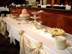 Sweets table with a beautiful wedding cake made of flowers.