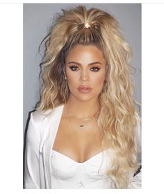 Khloe Kardashian - curly, half-up ponytail.