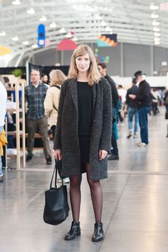 27 Brilliant Outfits From The World's Chicest Craft Fair #refinery29  http://www.refinery29.com/2014/12/78950/west-coast-craft-fair-style#slide-3  Artist Emily Proud makes black-on-black look anything BUT basic in Marc by Marc Jacobs boots, a Baggu bag, Silence & Noise jacket, and J.Crew  dress....
