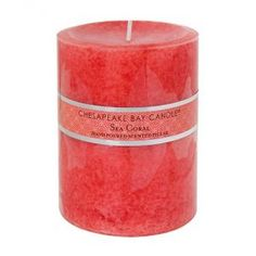 Coral salmon pink colored candle.