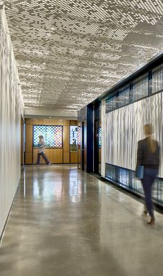 Vapor® ceiling systems offer a variety of patterns generated from simple, repeated elements. Panels are compatible with industry standard grid systems and their scrim-like design allows HVAC, lighting elements and other infrastructure to be shrouded yet fully operational. Optional backing materials can be added—frosted polycarbonate, to transmit light from above, or our Soft Sound® acoustical material, available in a wide range of colors, to reduce sound reverberation.