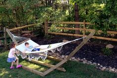 How to Make a Free-Standing Hammock Stand | Hunker Free Standing Hammock, Diy Outdoor Furniture, Outdoor Decor, Backyard Hammock, Wood Post, Avatar Airbender, Hammock Stand, Ladders, Outdoor Landscaping