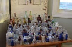 vintage sea glass bottle collection, vintage bottles, beach glass bottles