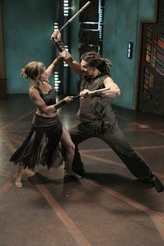 Teyla Emmagan and Ronon Dex doing escrima stick fighting. It's a beautiful and amazing martial art.