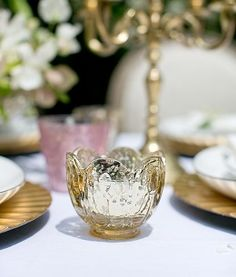 Bring an exotic ambiance to your home with the Gold Carraway Votive Holder. With its rose-tinted exterior and translucence, this luxurious mercury glass candle holder gives off a delightful glow when filled with a lit candle. Use this holder to accent Mercury Glass Candle Holders, Votive Candle Holders, Reception Decorations, Wedding Centerpieces, Table Decorations, Dark Wood Coffee Table, Save On Crafts, Cocktail Tables, Our Wedding