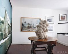 A Biedermeier table displays a sculpture made of paper plates by Tara Donovan. Tara Donovan, Jeff Wall, San Francisco Houses, All In The Family, Elle Decor, Accent Chairs, Joel Sternfeld, Paper Plates, Stephen Shore