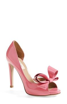 A peep-toe d'Orsay pump with a slender heel, dramatic sweep and fabulous bow is cast in perfectly pink leather.