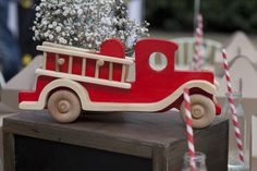 Use a gift to the birthday boy as decor for the party! Love the vintage wooden toy firetruck!